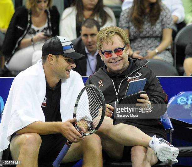 Singer Sir Elton John and tennis player Andy Roddick smiles during the Mylan World TeamTennis Matches at ESPN Wide World of Sports Complex on...