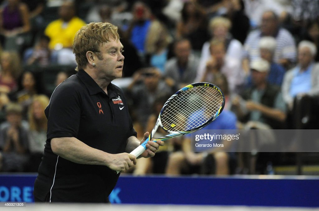 Singer Sir <a gi-track='captionPersonalityLinkClicked' href=/galleries/search?phrase=Elton+John&family=editorial&specificpeople=171369 ng-click='$event.stopPropagation()'>Elton John</a> plays during the Mylan World TeamTennis Matches at ESPN Wide World of Sports Complex on November 17, 2013 in Lake Buena Vista, Florida.