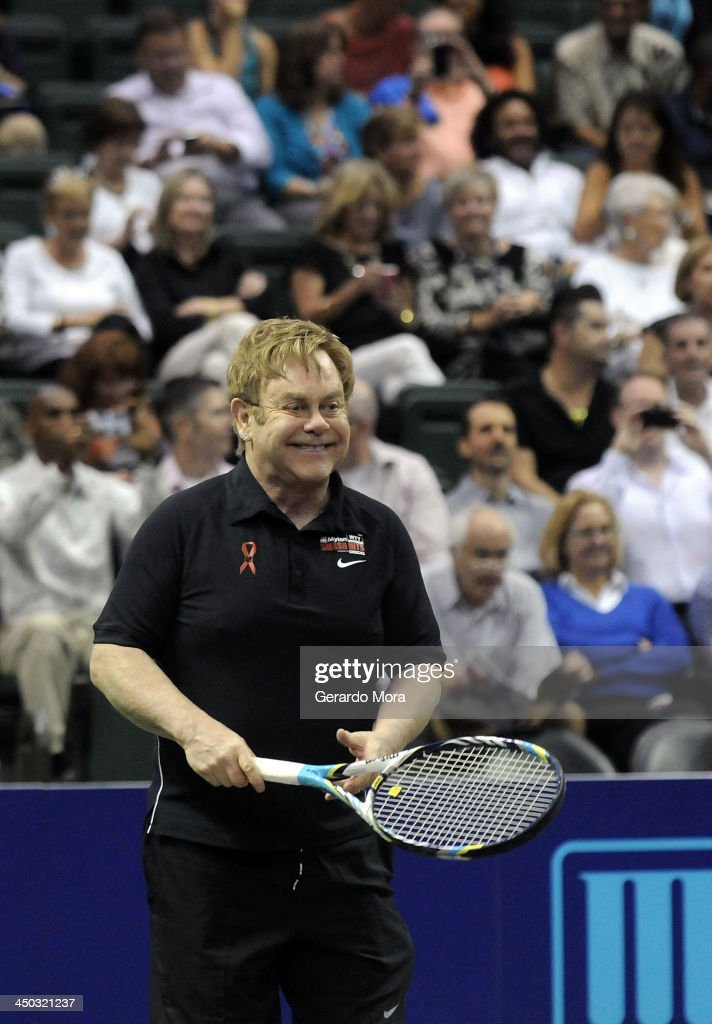 Singer Sir <a gi-track='captionPersonalityLinkClicked' href=/galleries/search?phrase=Elton+John&family=editorial&specificpeople=171369 ng-click='$event.stopPropagation()'>Elton John</a> smiles during the Mylan World TeamTennis Matches at ESPN Wide World of Sports Complex on November 17, 2013 in Lake Buena Vista, Florida.