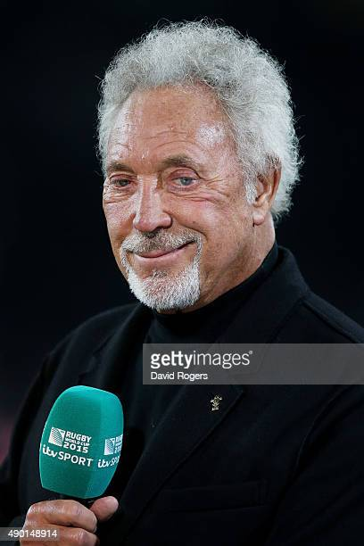 Singer Sir Tom Jones speaks to ITV Sport during the 2015 Rugby World Cup Pool A match between England and Wales at Twickenham Stadium on September 26...