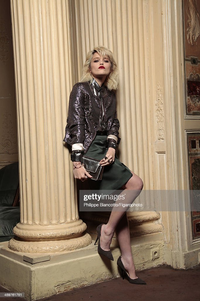 108317-046. Singer Sky Ferreira is photographed for Madame Figaro on November 4, 2013 in Paris, France. Jacket (Eleven Paris), shirt (& Other Stories), skirt (Anthony Vaccarello), clutch (Marni), bracelet and ring (Chaumet), ring (Dior), shoes (Jimmy Choo).