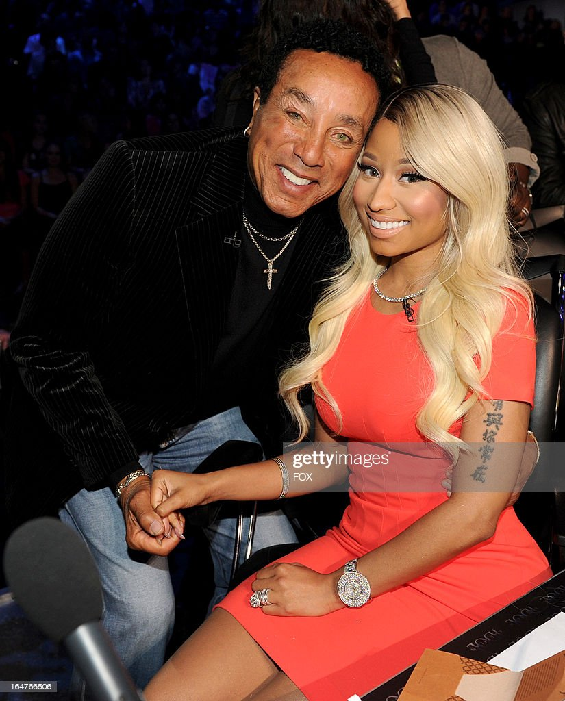 Singer Smokey Robinson (L) and judge Nicki Minaj at FOX's 'American Idol' Season 12 Top 8 Live Performance Show on March 27, 2013 in Hollywood, California.