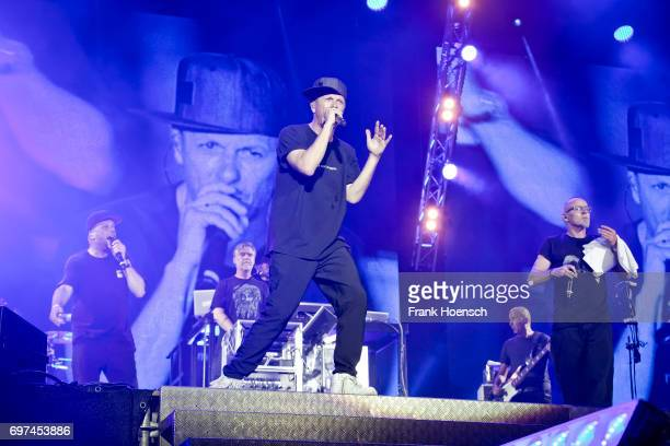 Singer Smudo AndYpsilon Thomas D and Michi Beck of the German band Die Fantastischen Vier perform live on stage during the Peace X Peace Festival at...