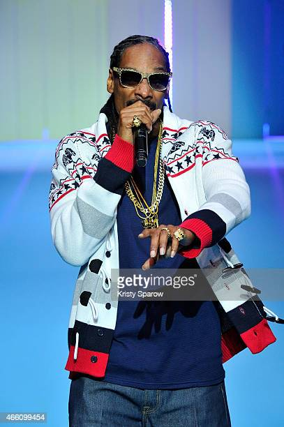 Singer Snoop Dogg performs during the ETAM show finale as part of Paris Fashion Week Womenswear Fall/Winter 2015/2016 at Piscine Molitor on March 3...