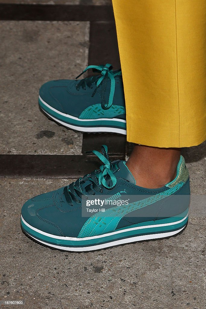 Singer <a gi-track='captionPersonalityLinkClicked' href=/galleries/search?phrase=Solange+Knowles&family=editorial&specificpeople=221489 ng-click='$event.stopPropagation()'>Solange Knowles</a> (Puma shoe detail) celebrates the release of her 'Saint Heron' compilation album outside of Opening Ceremony in Soho on November 10, 2013 in New York City.