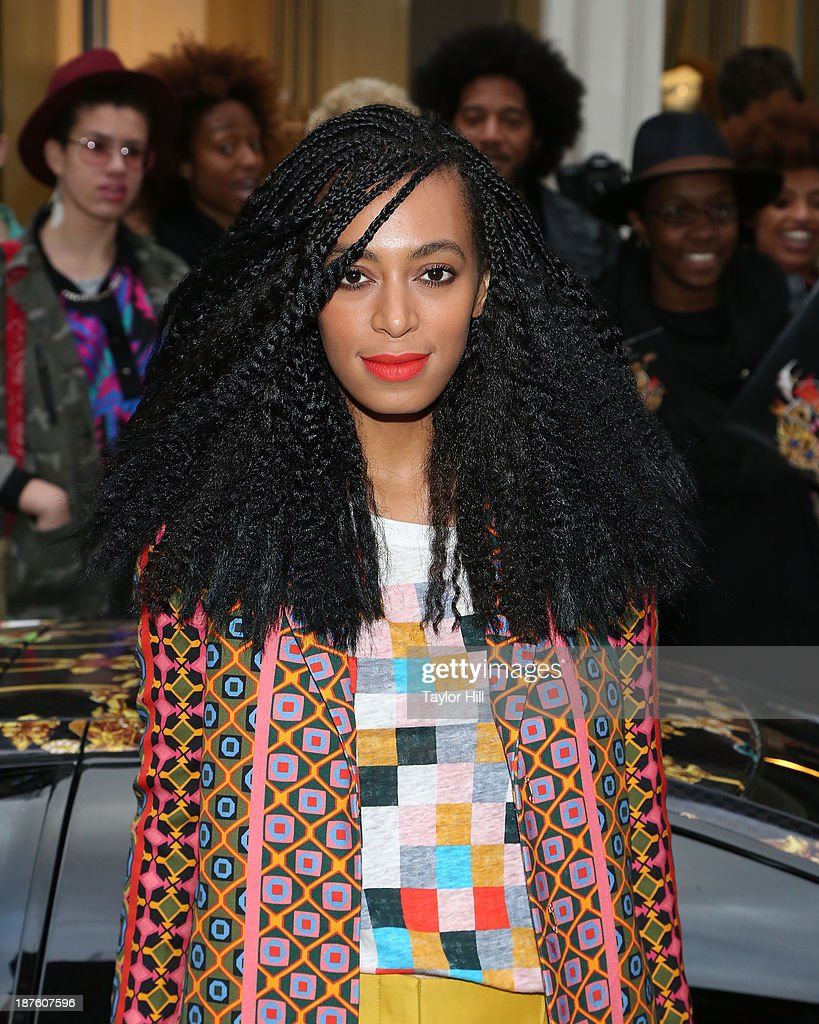 Singer <a gi-track='captionPersonalityLinkClicked' href=/galleries/search?phrase=Solange+Knowles&family=editorial&specificpeople=221489 ng-click='$event.stopPropagation()'>Solange Knowles</a> poses in front of a Lamborghini Murcielago decorated by Rashaad Newsome to celebrate the release of her 'Saint Heron' compilation album at Opening Ceremony in Soho on November 10, 2013 in New York City.
