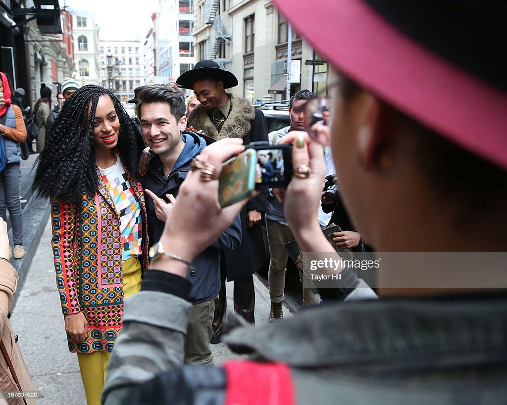 Singer <a gi-track='captionPersonalityLinkClicked' href=/galleries/search?phrase=Solange+Knowles&family=editorial&specificpeople=221489 ng-click='$event.stopPropagation()'>Solange Knowles</a> poses with fans to celebrate the release of her 'Saint Heron' compilation album outside Opening Ceremony in Soho on November 10, 2013 in New York City.