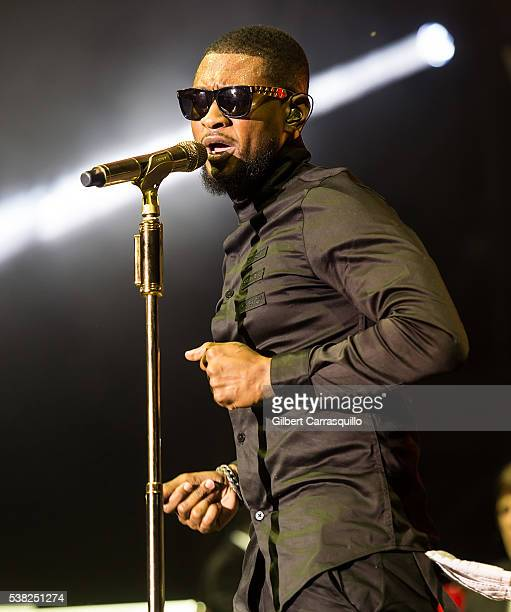 Singer songwriter actor Usher performs with The Roots Crew performs during 9th Annual Roots Picnic at Festival Pier at Penn's Landing on June 4 2016...