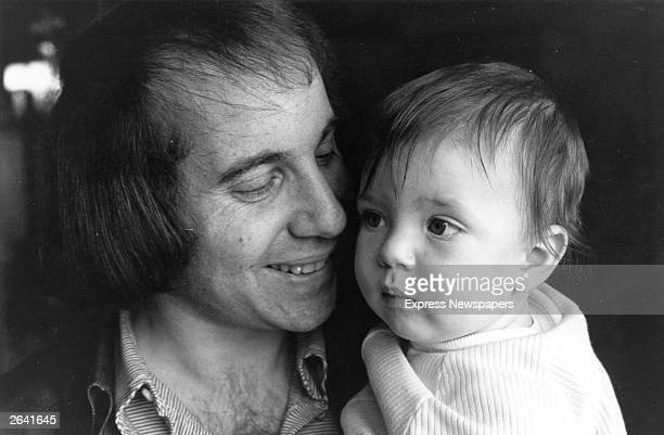 Singer songwriter and guitarist Paul Simon famous for his partnership with Art Garfunkel He is pictured with his son Harper