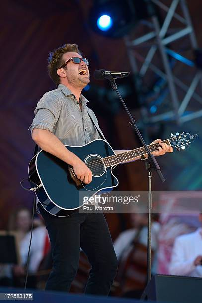 Singer Songwriter Howie Day performs with Keith Lockhart and the Boston Pops at the Fourth Of July Firework Spectacular Rehearsals on July 3 2013 in...