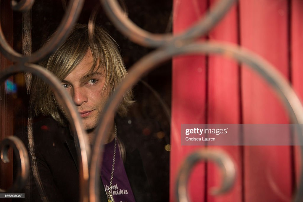 Singer / songwriter Keith Harkin poses backstage at Genghis Cohen Lounge on April 17, 2013 in Los Angeles, California.