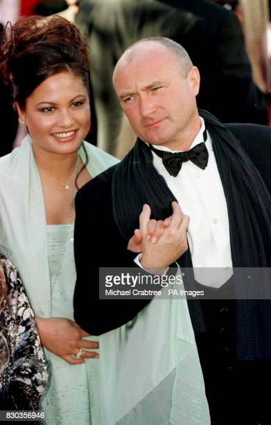Singer Songwriter Phil Collins and his wife Orianne arrive for the 72nd Annual Academy Awards at the Shrine Auditorium in Los Angeles USA Collins won...