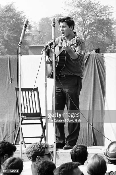 Singer songwriter Phil Ochs performs at the Newport Folk Festival in July 1963 in Newport Rhode Island