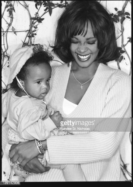 Singer/ songwriter Whitney Houston and singer Bobby Brown are photographed with their baby daughter Bobbi Kristina Houston