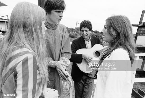 Singer songwriters Joni Mitchell an unidentified friend of Ms Mitchell Leonard Cohen and Judy Collins backstage at the Newport Folk Festival in July...