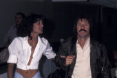 Singer Sonny Bono and girlfriend Susie Coelho on April 5 1977 arrive at the Los Angeles International Airport in Los Angeles California