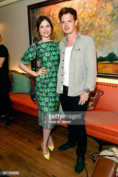Singer Sophie EllisBextor and her husband Richard Jones attend the Daphne's restaurant 50th Anniversary Party at Daphne's on June 24 2014 in London...
