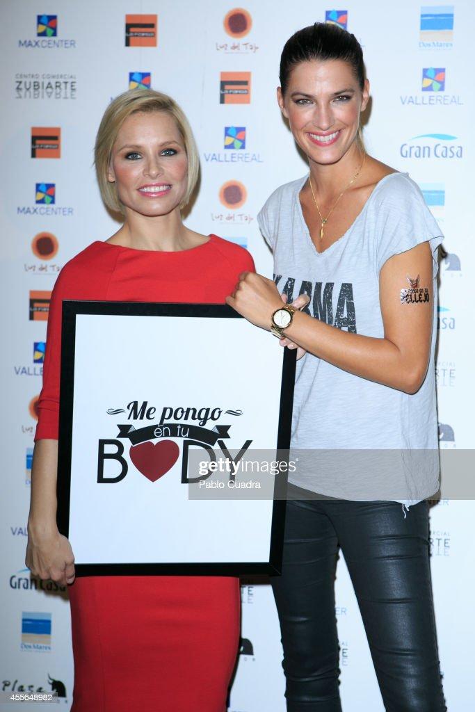 Singer Soraya Arnelas and model Laura Sanchez pose during a photocall to present 'Me Pongo En Tu Piel' on September 18 2014 in Madrid Spain
