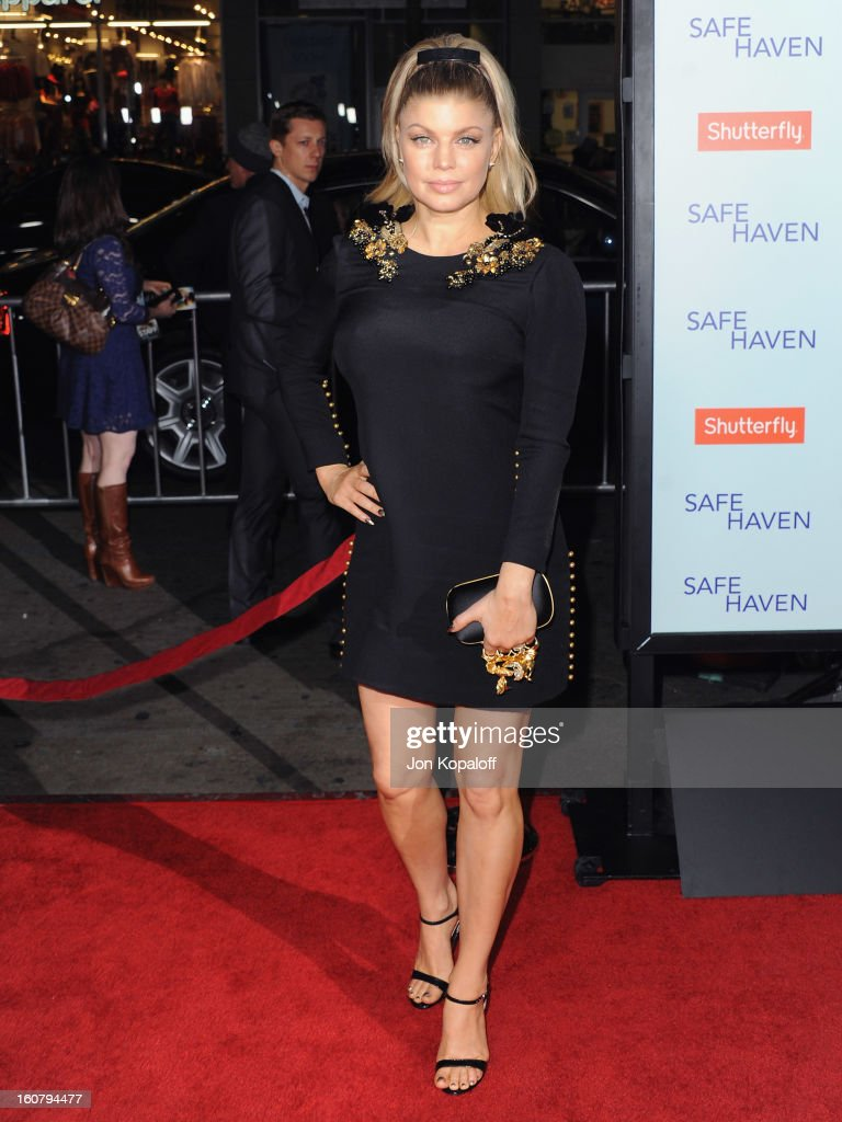 Singer Stacy 'Fergie' Ferguson arrives at the Los Angeles Premiere 'Safe Haven' at TCL Chinese Theatre on February 5, 2013 in Hollywood, California.