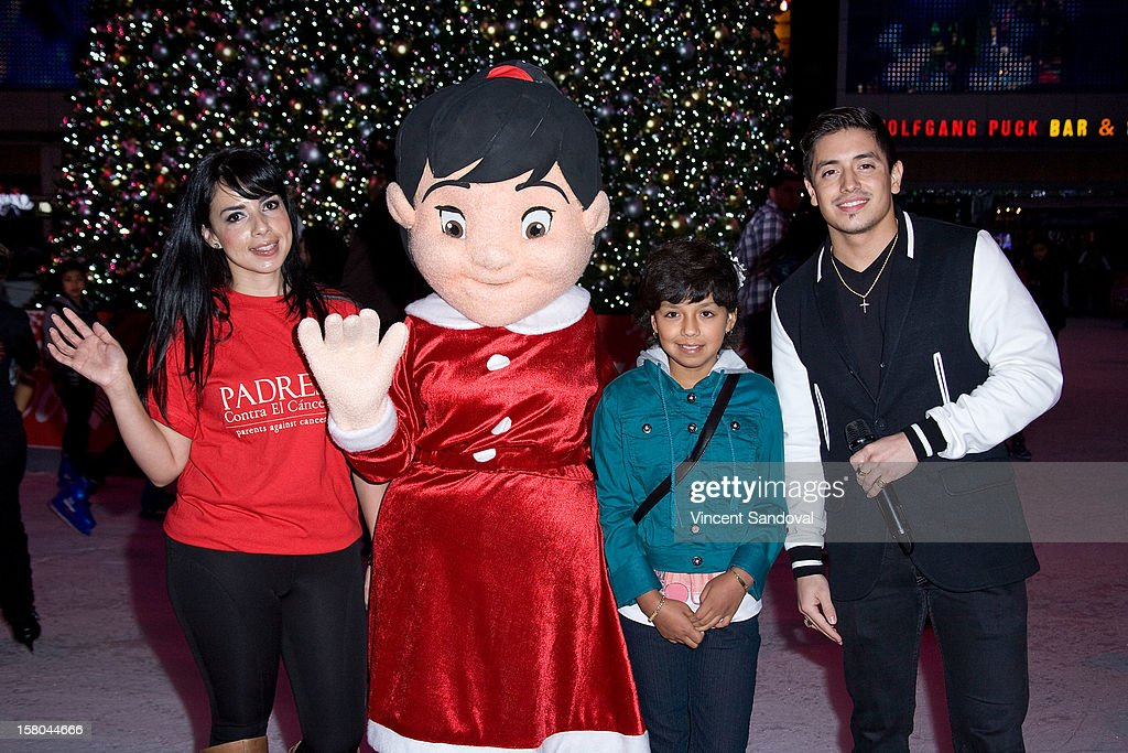 Singer Stefano Langone (R) attends AEG's Season of Giving honoring PADRES Contra El Cancer during a special on-ice presentation at the LA Kings Holiday Ice at Nokia Plaza L.A. LIVE on December 9, 2012 in Los Angeles, California.