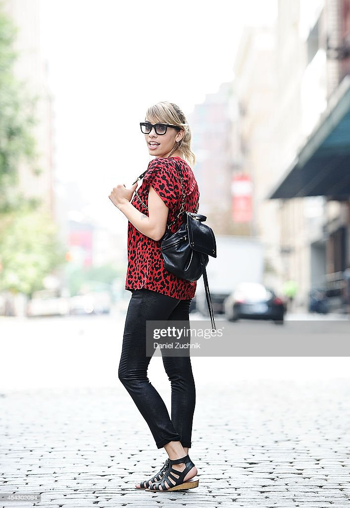 Singer Stella Santana is seen around Tribeca wearing a Saint Laurent t-shirt, Kooples pants, Jerome Dreyfuss bookbag, and Indiigo sunglasses on August 28, 2014 in New York City.
