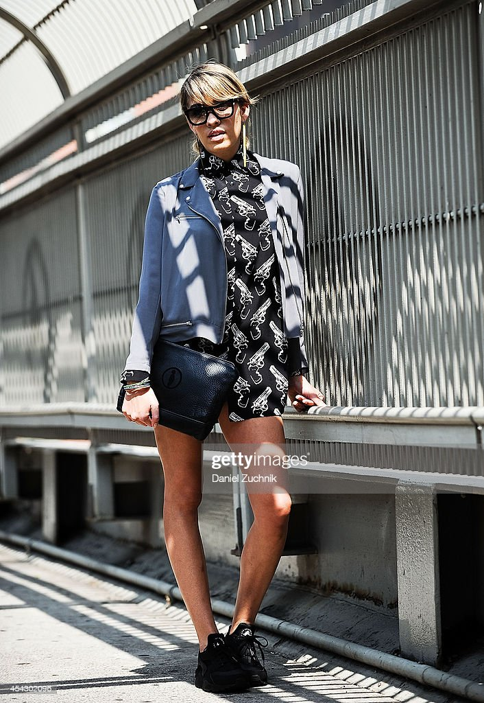Singer Stella Santana is seen around Tribeca wearing The Kooples jacket, Saint Laurent pistol shirt, Nike Huaraches sneakers with Indiigo and Mozie purse and sunglasses on August 28, 2014 in New York City.