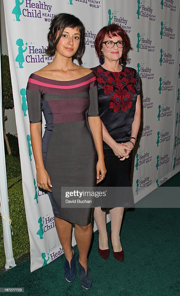 Singer Stephanie Hunt (L) and actress Megan Mullally attends the Mom On A Mission's 5th Annual Awards & Gala on November 6, 2013 in Pacific Palisades, California.
