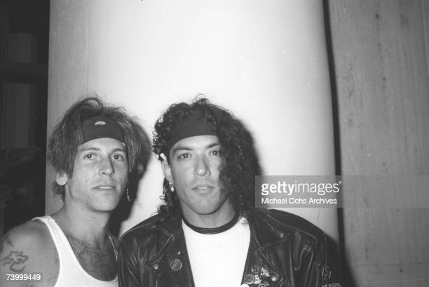 Singer Stephen Pearcy of the rock band 'Ratt' and guitarist Tracii Guns of the rock band 'LA Guns' pose for a portrait at the Golden Monkey Club Cafe...