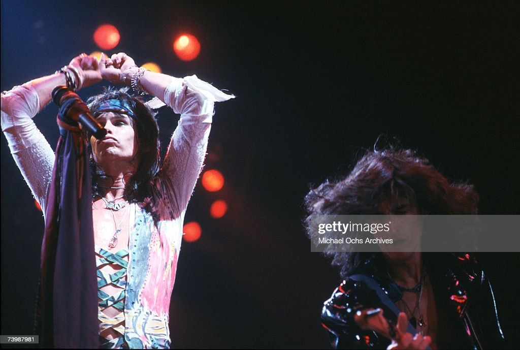Singer Steven Tyler and guitarist Joe Perry of the Rock and roll band 'Aerosmith' perform onstage in 1987 in Los Angeles California