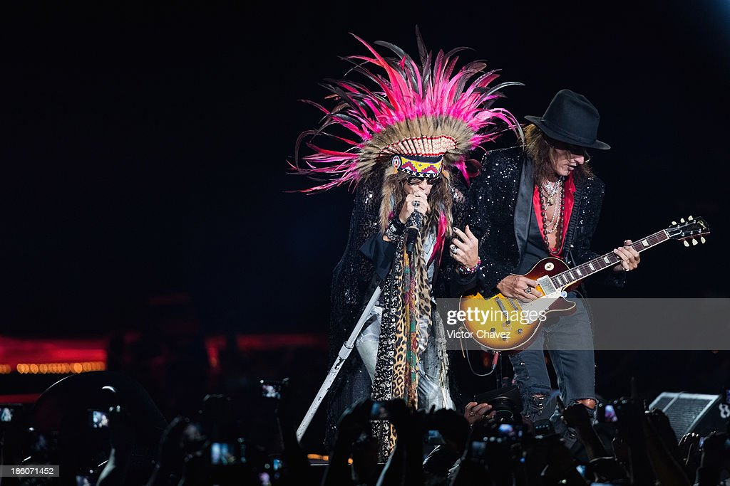 Singer Steven Tyler and Joe Perry of Aerosmith perform on stage at Arena Ciudad de México on October 27, 2013 in Mexico City, Mexico.