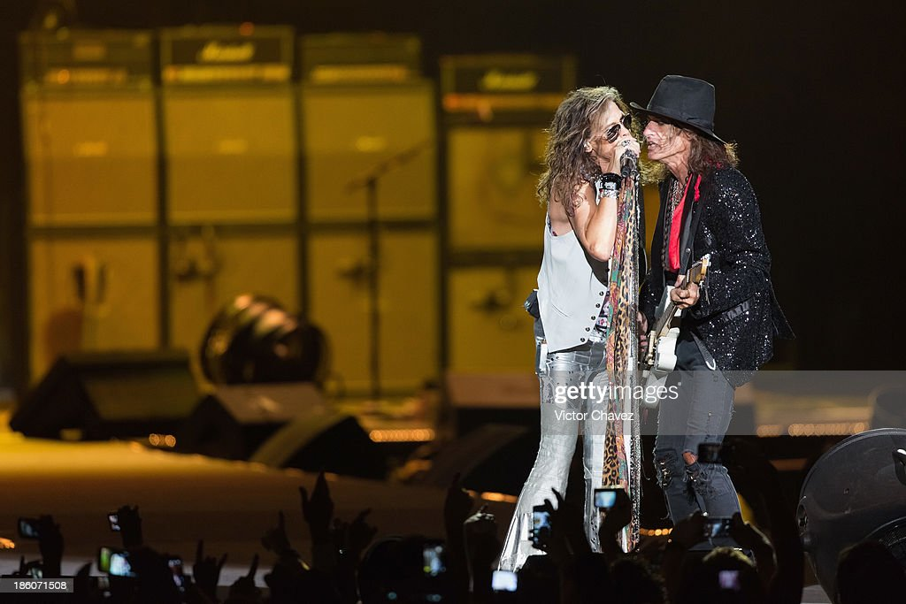 Singer <a gi-track='captionPersonalityLinkClicked' href=/galleries/search?phrase=Steven+Tyler+-+Musician&family=editorial&specificpeople=202080 ng-click='$event.stopPropagation()'>Steven Tyler</a> and <a gi-track='captionPersonalityLinkClicked' href=/galleries/search?phrase=Joe+Perry+-+Musician&family=editorial&specificpeople=13600677 ng-click='$event.stopPropagation()'>Joe Perry</a> of Aerosmith perform on stage at Arena Ciudad de México on October 27, 2013 in Mexico City, Mexico.