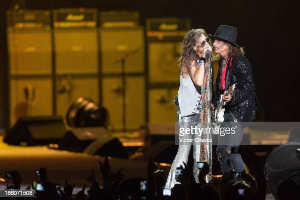 Singer Steven Tyler and Joe Perry of Aerosmith perform on stage at Arena Ciudad de México on October 27 2013 in Mexico City Mexico