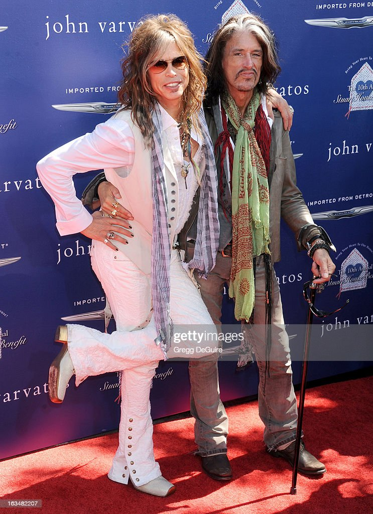 Singer <a gi-track='captionPersonalityLinkClicked' href=/galleries/search?phrase=Steven+Tyler+-+Musician&family=editorial&specificpeople=202080 ng-click='$event.stopPropagation()'>Steven Tyler</a> and musician <a gi-track='captionPersonalityLinkClicked' href=/galleries/search?phrase=Joe+Perry+-+Musician&family=editorial&specificpeople=13600677 ng-click='$event.stopPropagation()'>Joe Perry</a> of 'Aerosmith' arrive at John Varvatos 10th Annual Stuart House Benefit at John Varvatos Los Angeles on March 10, 2013 in Los Angeles, California.