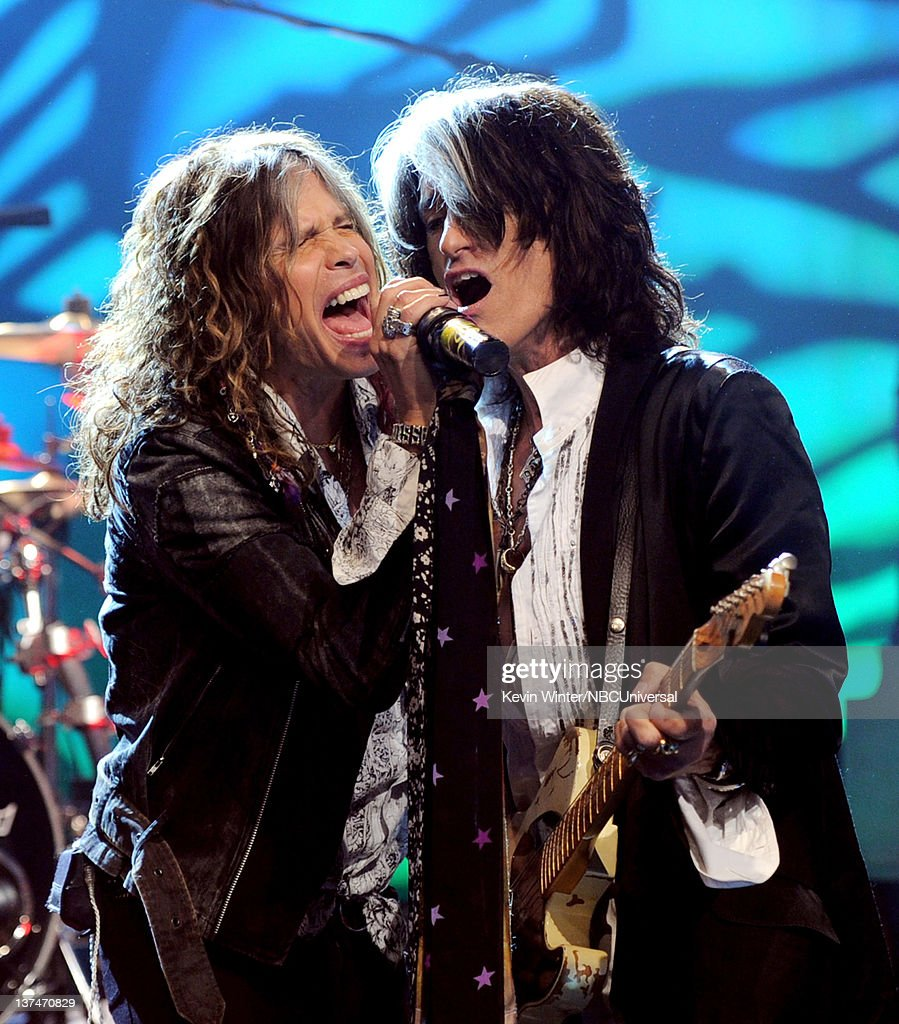 Singer <a gi-track='captionPersonalityLinkClicked' href=/galleries/search?phrase=Steven+Tyler+-+Musician&family=editorial&specificpeople=202080 ng-click='$event.stopPropagation()'>Steven Tyler</a> (L) and musician <a gi-track='captionPersonalityLinkClicked' href=/galleries/search?phrase=Joe+Perry+-+Musician&family=editorial&specificpeople=13600677 ng-click='$event.stopPropagation()'>Joe Perry</a> of Aerosmith perform on the Tonight Show With Jay Leno at NBC Studios on January 20, 2012 in Burbank, California.