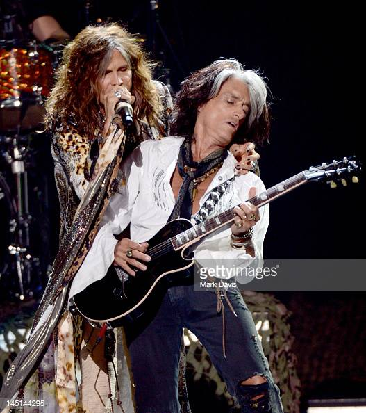 Singer Steven Tyler and musician Joe Perry of Aerosmith perform onstage during Fox's 'American Idol 2012' results show at Nokia Theatre LA Live on...