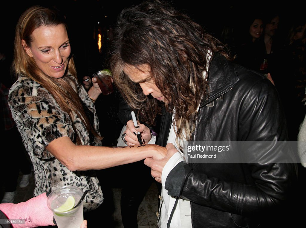 Singer <a gi-track='captionPersonalityLinkClicked' href=/galleries/search?phrase=Steven+Tyler+-+Musician&family=editorial&specificpeople=202080 ng-click='$event.stopPropagation()'>Steven Tyler</a> (R) attends Sunset Marquis Hotel 50th Anniversary Birthday Bash at Sunset Marquis Hotel & Villas on November 16, 2013 in West Hollywood, California.