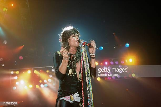 Singer Steven Tyler performing on stage with American rock group Aerosmith August 1988