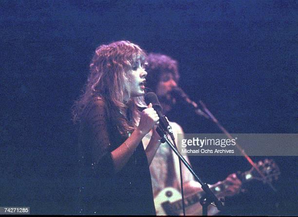 Singer Stevie Nicks and guitarist Lindsey Buckingham of the rock group 'Fleetwood Mac' perform onstage in circa 1977