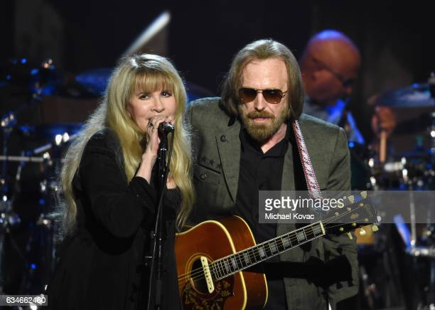 Singer Stevie Nicks and honoree Tom Petty perform onstage during MusiCares Person of the Year honoring Tom Petty at the Los Angeles Convention Center...