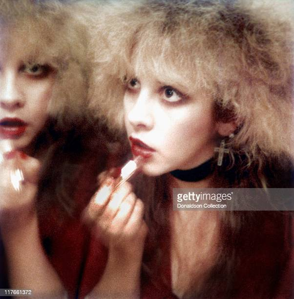 Singer Stevie Nicks puts on lipstick backstage in 1985 in Los Angeles California