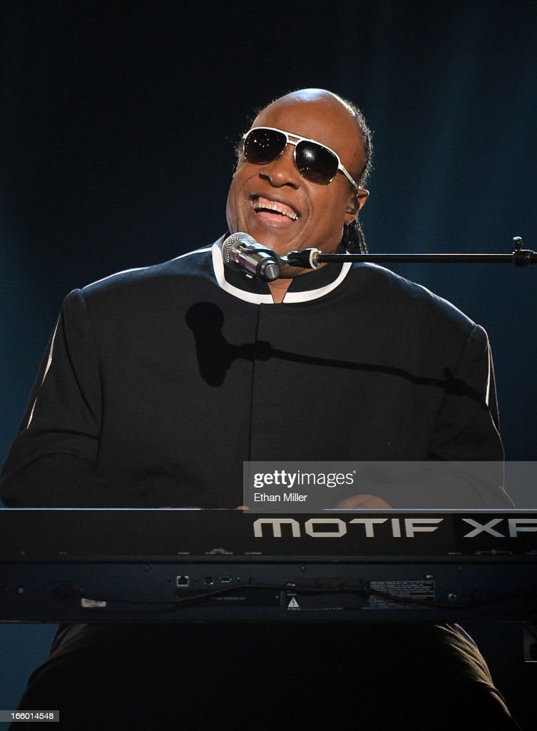 Singer <a gi-track='captionPersonalityLinkClicked' href=/galleries/search?phrase=Stevie+Wonder&family=editorial&specificpeople=171911 ng-click='$event.stopPropagation()'>Stevie Wonder</a> performs onstage during the 48th Annual Academy of Country Music Awards at the MGM Grand Garden Arena on April 7, 2013 in Las Vegas, Nevada.