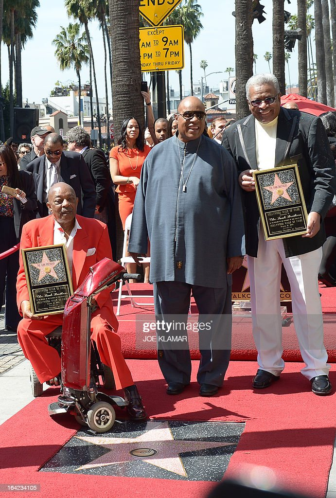 Singer Stevie Wonder (C) poses with Eddie Willis (L) and Jack Ashford, surviving members of the Funk brothers, as they attend a ceremony honoring the musicians with a star on the Hollywood Walk of Fame on March 21, 2013 in Hollywood, California.The Funk Brothers was the nickname of Detroit, Michigan, session musicians who performed the backing to most Motown recordings from 1959 until the company moved to Los Angeles in 1972.