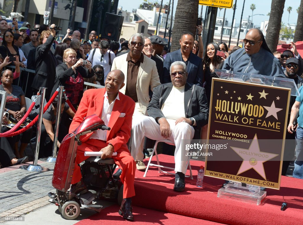 Singer Stevie Wonder speaks (R) as Jack Ashford (C) and Eddie Willis (L), surviving members of the Funk Brothers, attend a ceremony honoring the musicians with a star on the Hollywood Walk of Fame on March 21, 2013 in Hollywood, California.The Funk Brothers was the nickname of Detroit, Michigan, session musicians who performed the backing to most Motown recordings from 1959 until the company moved to Los Angeles in 1972. AFP PHOTO/JOE KLAMAR
