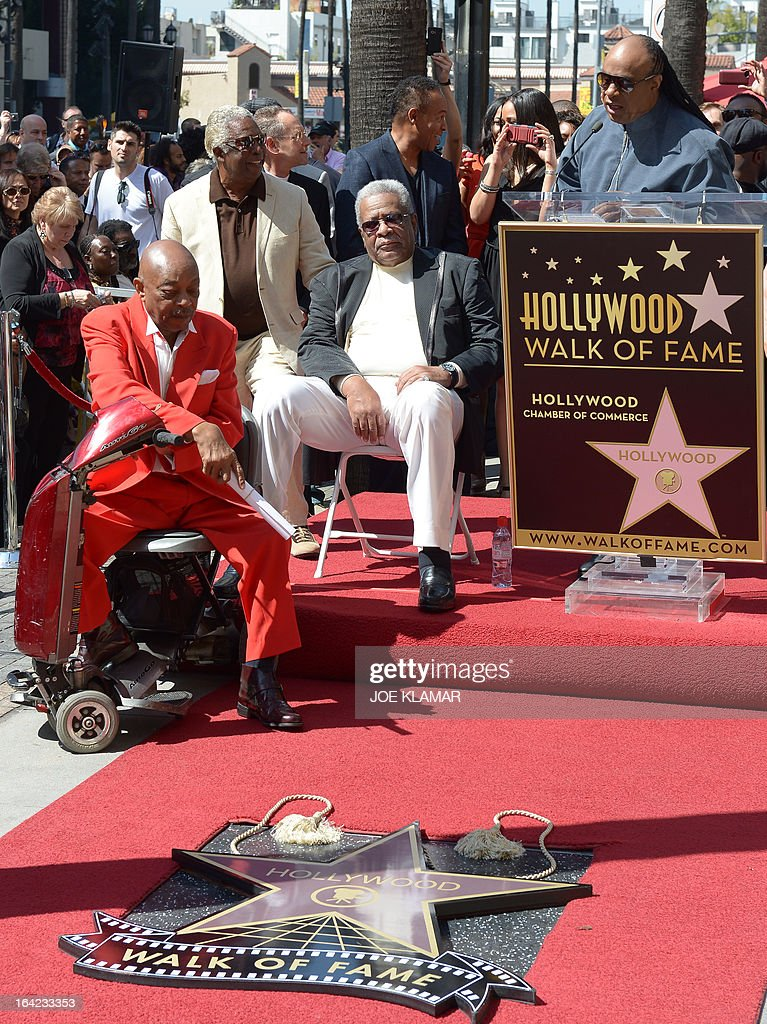 Singer Stevie Wonder (R) speaks as Jack Ashford (C) and Eddie Willis (L), surviving members of the Funk Brothers, attend a ceremony honoring the musicians with a star on the Hollywood Walk of Fame on March 21, 2013 in Hollywood, California.The Funk Brothers was the nickname of Detroit, Michigan, session musicians who performed the backing to most Motown recordings from 1959 until the company moved to Los Angeles in 1972.