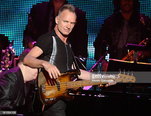 Singer Sting performs onstage at The 2013 MusiCares Person Of The Year Gala Honoring Bruce Springsteen at Los Angeles Convention Center on February 8...