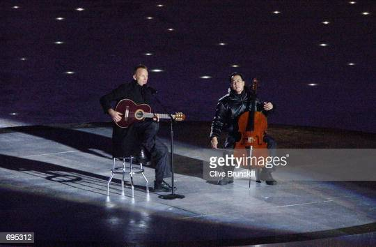 Singer Sting performs with cellist Yo Yo Ma during the Opening Ceremony of the Salt Lake City Winter Olympic Games at the RiceEccles Olympic Stadium...