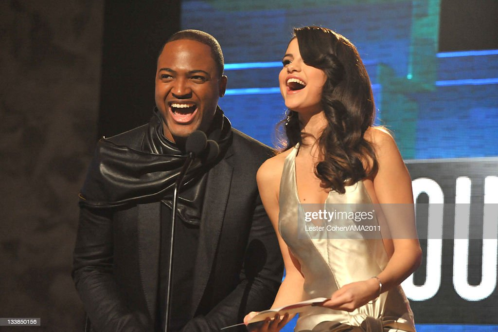 Singer <a gi-track='captionPersonalityLinkClicked' href=/galleries/search?phrase=Taio+Cruz&family=editorial&specificpeople=5017613 ng-click='$event.stopPropagation()'>Taio Cruz</a> (L) and singer <a gi-track='captionPersonalityLinkClicked' href=/galleries/search?phrase=Selena+Gomez&family=editorial&specificpeople=4295969 ng-click='$event.stopPropagation()'>Selena Gomez</a> onstage at the 2011 American Music Awards held at Nokia Theatre L.A. LIVE on November 20, 2011 in Los Angeles, California.