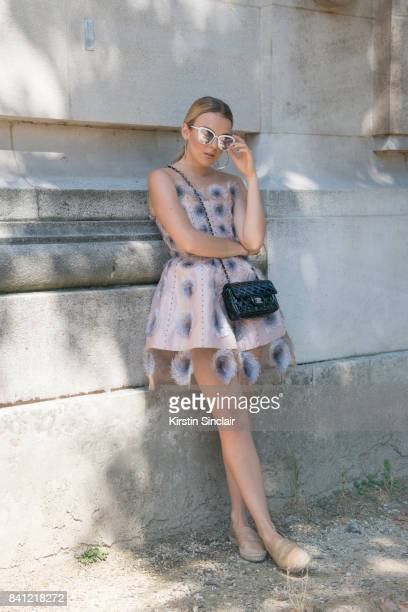 Singer Tallia Storm wears a Chanel dress shoes and bag and Quay sunglasses day 3 of Paris Haute Couture Fashion Week Autumn/Winter 2017 on July 4...