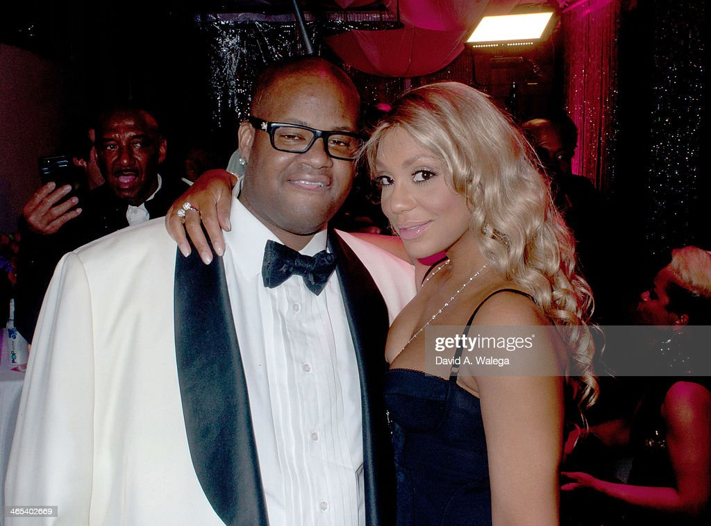 Singer Tamar Braxton with husband record producer Vincent 'Vince' Herbert arrive at Xen Lounge for a Night To Celebrate Tamar Braxton's GRAMMY Nominations on January 26, 2014 in Los Angeles, California.
