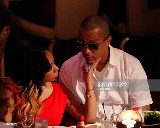 Singer Tameka 'Tiny' Cottle and Clifford 'TI' Harris attend The Andrew Young Foundation's celebration of the 80th birthday of Andrew Young at The...